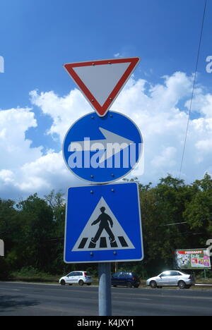 Road signs indicating give way, one way, pedestrian crossing, Budapest, Hungary - Stock Photo