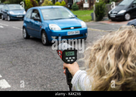 Brentwood Essex 6th September 2017.Community volunteers monitor the speeds of vehicles with a hand-held measurement - Stock Photo