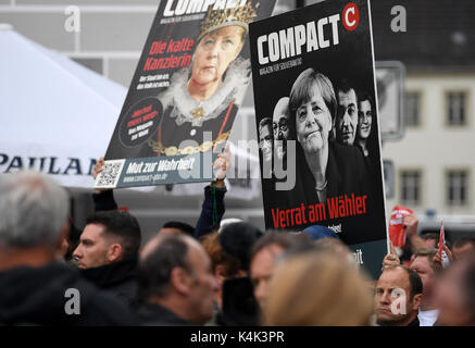 Supporters of different political parties voice their opinion during an CDUelection campaign in Torgau, Germany, - Stock Photo
