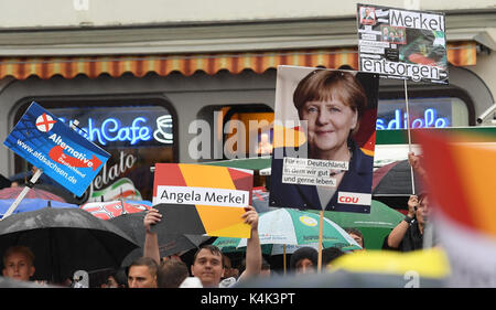 Supporters of different political parties voice their opinion during an CDU election campaign in Torgau, Germany, - Stock Photo