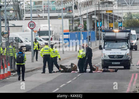 London, UK. 6th September 2017. Two protesters have managed to get inside the gates of the ExCeL centre and have - Stock Photo