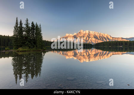 Two Jack Lake, Mount Rundle, Reflection at sunrise, Banff National Park, Canadian Rocky Mountains, Alberta, Canada - Stock Photo