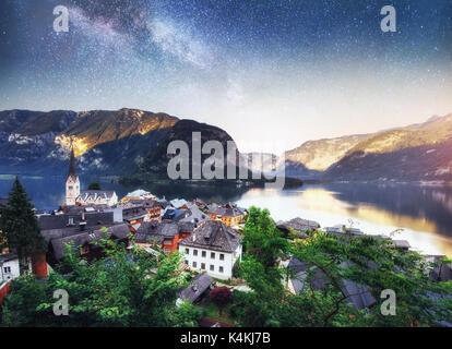Scenic panoramic view of the famous mountain village in the Austrian Alps. Fantastic milky way. Hallstatt. Austria