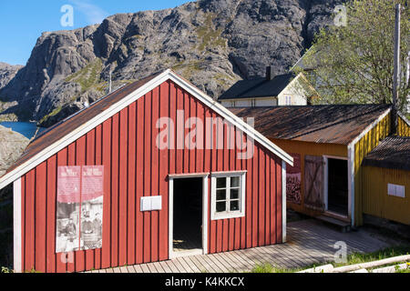 The Red Boat Shed with bilingual tourist information in historic fishing village of Nusfjord, Flakstadøya Island, - Stock Photo