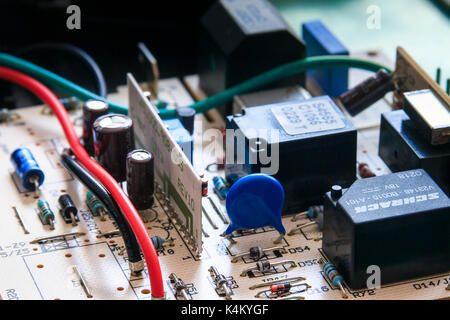 Close-up of electronic components and wires on a printed circuit board - Stock Photo