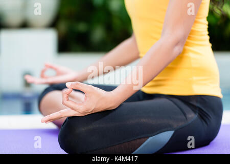 a woman in a meditation pose at a buddhist temple near