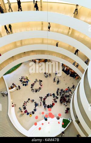 Visitors and schoolchildren, interior of Solomon R. Guggenheim Museum, Manhattan, New York City, USA, North America - Stock Photo