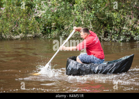 Coracle,boat,traditional,fishing,craft,race,races,racing,on,River,Teifi,at,village,of,Cilgerran,near,Cardigan,North,Pembrokeshire,Wales,U.K.,UK, - Stock Photo