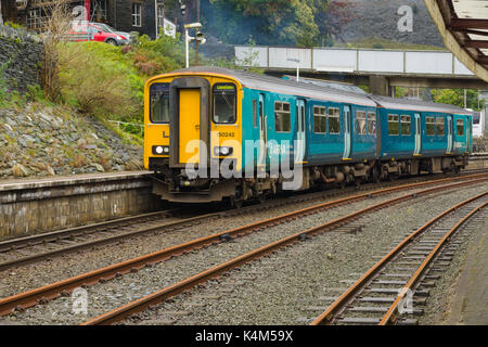 Arriva Trains Wales passenger train departing the station at Blaenau Ffestiniog North Wales - Stock Photo