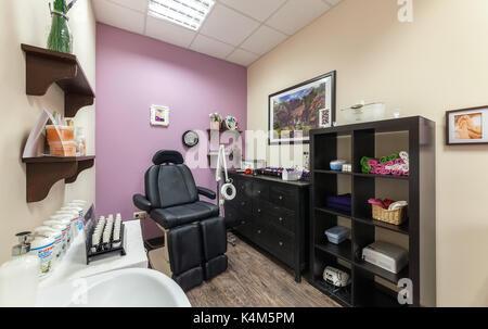 Interior of luxury beauty salon Philosofiya Stilya. The beautician room. - Stock Photo