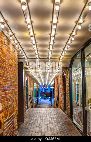 Washington DC, USA - August 4, 2017: Illuminated alley with lights in evening passage in downtown Georgetown neighborhood - Stock Photo
