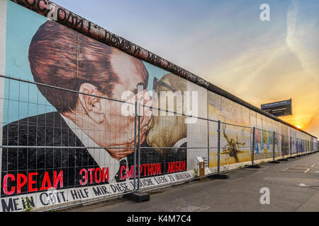 BERLIN, GERMANY: MAY 10, 2017: Berlin skyline sunset at Famous Berlin Wall, Berlin, Germany - Stock Photo