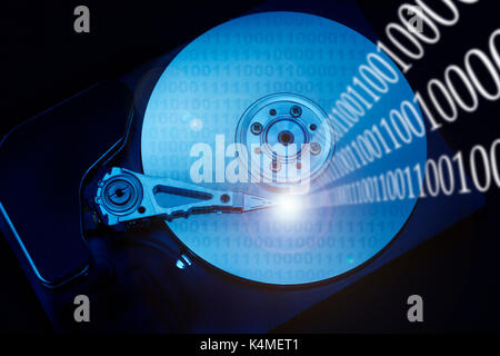 hard disk and binary digits, data managing and computing concept - Stock Photo