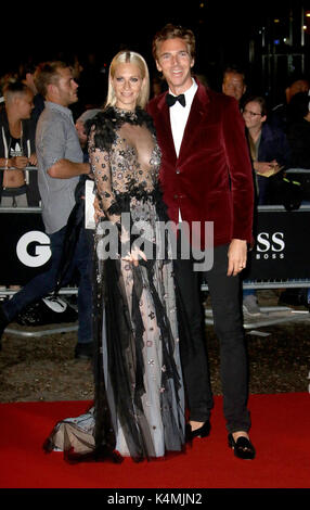 LONDON - SEP 05, 2017: Poppy Delevingne and James Cook attend the GQ Men of the Year Awards at theTate Modern in - Stock Photo