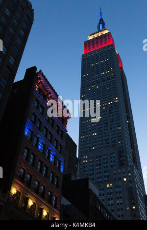 Empire State Building Looms over the Ditson Building at Dusk, NYC, USA - Stock Photo