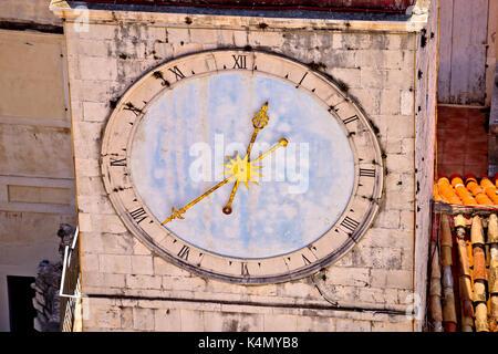 Town of Trogir main square clock tower closeup view, UNESCO world heritage site in Croatia - Stock Photo