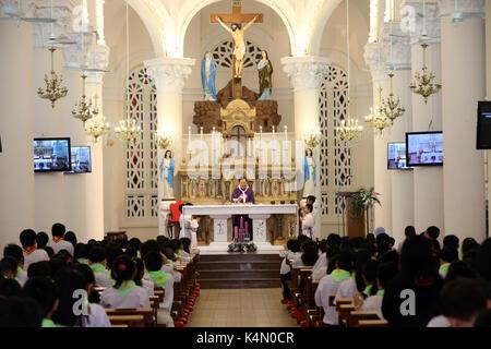 Church of the Sacred Heart of Jesus (Nha Tho Tan Dinh), Sunday Mass celebration, Ho Chi Minh City, Vietnam, Indochina, - Stock Photo