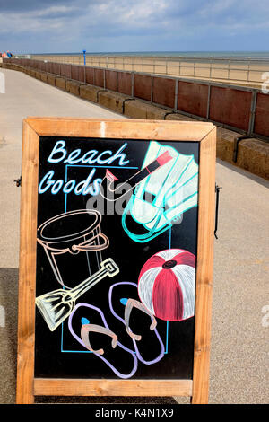 Sutton-on-Sea, Lincolnshire, UK. August 19, 2017. A artistic sandwich chalkboard advertising beach goods on sale - Stock Photo