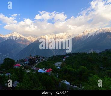 Kalpa village and Kinnaur Kailash sacred peak at sunrise view - Stock Photo