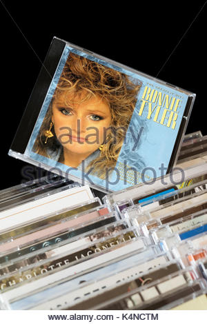 The Greatest Hits, Bonnie Tyler CD pulled out from among rows of other CD's, Dorset, England - Stock Photo