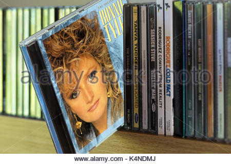The Greatest Hits, Bonnie Tyler CD pulled out from among other CD's on a shelf, Dorset, England - Stock Photo