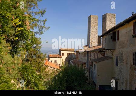 The Torri dei Salvucci from Via della Rocca, San Gimignano, Tuscany, Italy - Stock Photo