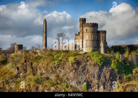 View of Calton Hill in Edinburgh Scotland with Martyr's Monument and Governors House in the Foreground - Stock Photo