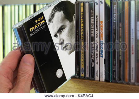 Ramblin' Boy, Tom Paxton 2nd CD being chosen from a shelf of other CD's, Dorset, England - Stock Photo