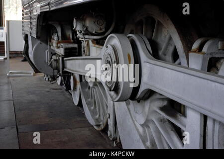 Hudson class 4-6-4  steam locomotive drive wheels on display in the engine shop of the B&O Railroad Museum, Baltimore, - Stock Photo