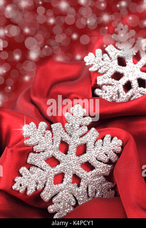 Snowflake on the red satin background