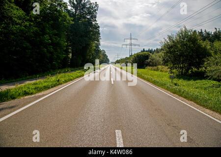 A long, straight (Roman) road near Memmingen, Bavaria, Germany - Stock Photo
