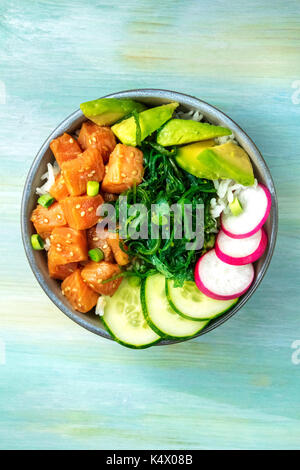 Hawaiian salmon poke salad with copy space - Stock Photo