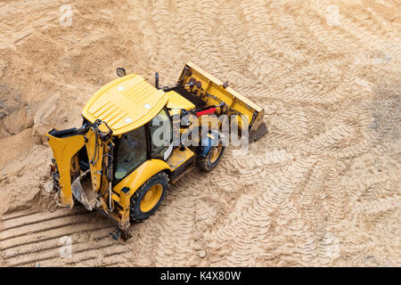 Construction of concrete foundation of new building. Construction machinery, excavator, top view - Stock Photo