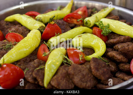 Beef cutlets baked on the grill with vegetables and sweet peppers and tomatoes - Stock Photo