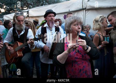 Folk music group of musicians performing outside in pub garden. London Uk HOMER SYKES - Stock Photo