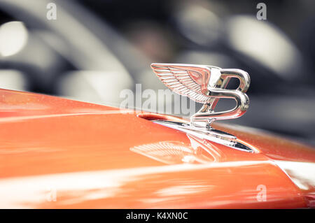 WROCLAW, POLAND -  AUGUST 19th, 2017: Hood ornament on a vintage Bentley car. Bentley Motors Limited is a British - Stock Photo