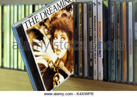 The Dreaming, Kate Bush CD pulled out from among other CD's on a shelf, Dorset, England - Stock Photo