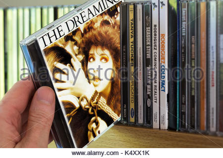 The Dreaming, Kate Bush CD being chosen from a shelf of other CD's, Dorset, England - Stock Photo