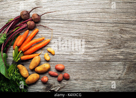 Various fresh vegetables and ingredients on wooden rustic background - Stock Photo