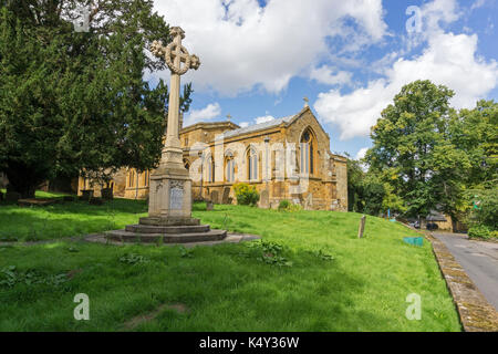 The church of St Mary The Virgin with the war memorial to the front, Dallington Village, Northampton, UK - Stock Photo