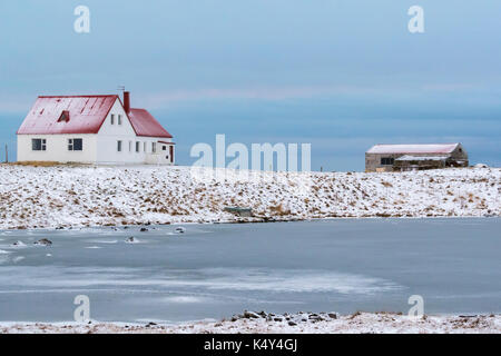 White House With Red Roof In Blikalon, Iceland - Stock Photo