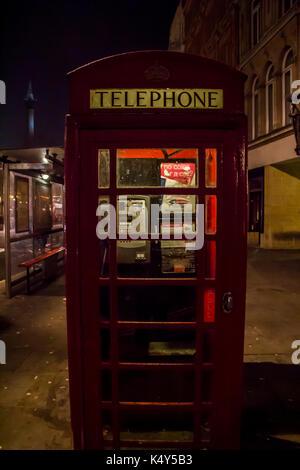 United Kingdom, England, London - 2017 January 23: Popular tourist Red phone booth in night lights illumination - Stock Photo