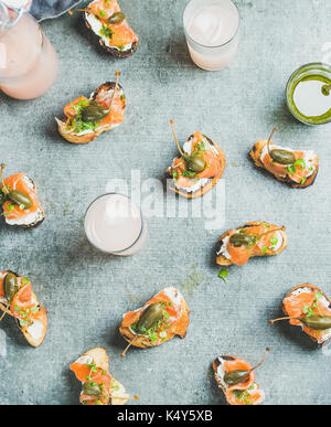 Crostini with smoked salmon and grapefruit cocktails, top view, flat-lay - Stock Photo