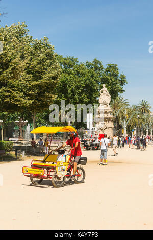 BARCELONA: Overview of Citadel park on September 2, 2017 in Barcelona, Spain. Unknown people and a tricycle, stroll - Stock Photo