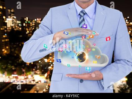 Digital composite of businessman with cloud between his hands and earth on cloud and applications icons coming up - Stock Photo