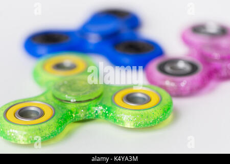 close up of fidget spinners on white background - Stock Photo
