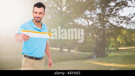 Digital composite of Delivery man with letters against blurry park with flares - Stock Photo