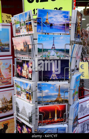 A rack of postcards for tourists near the Eiffel Tower in Paris - Stock Photo
