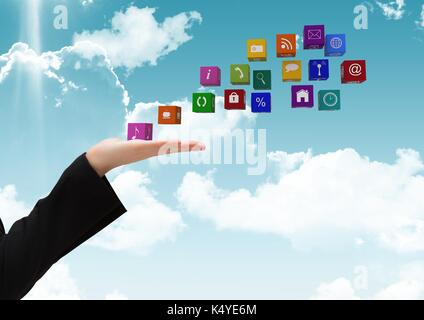 Digital composite of hand with application icons going out to fly on the sky - Stock Photo