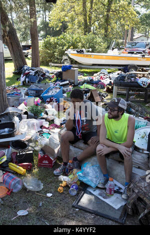 USA. 07th Sep, 2017. Baytown, Texas USA Sept. 7, 2017: Eric Grafton, Brandon Hawley and Shawn Curry sit in front - Stock Photo